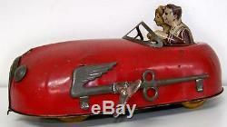1900s KEY-WIND CLOCKWORK PRESSED STEEL & TIN FUTURISTIC 2-PASSENGER CRAZY CAR