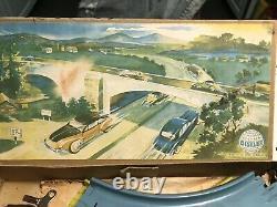 1940s DISTLER ORANGE TIN WIND UP TOY CAR, TRACK IN BOX US ZONE GERMANY WORKS