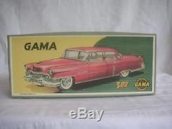 ALL ORIGINAL GAMA CADILLAC 1954 LIGHT BLUE TIN FRICTION CAR With REPRO BOX