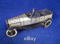 C1915 Burnett Clockwork Tinplate Touring Car & Chauffeur