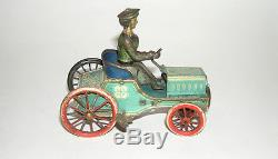 German Tin STOCK Automobile Car with Women Driver Clockwork Toy (DAKOTApaul)