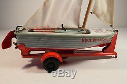 NEW CAR (FORD) WITH SAILBOAT TRAILER, Japan Haji friction tin toy 1950s MIB RARE