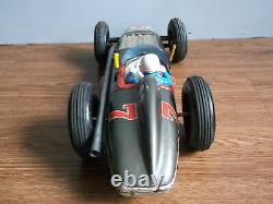 Old vintage battery powered huge 17 inch, tin Sports car of 50's, made in Japan