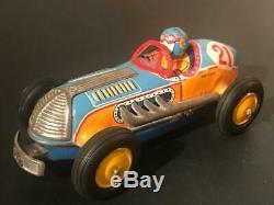 Scarce 1950's Japan Tin Friction Toy Break-Apart Hood Crash Race Car with Driver