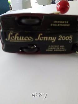 Schuco Sonny wind-up car with mouse U. S. Zone Germany