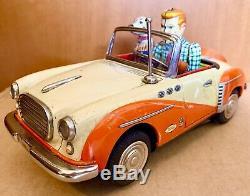 T. N NOMURA Spyder Convertible DRIVING PET Tin Litho Dog Car Battery Japan 1950s