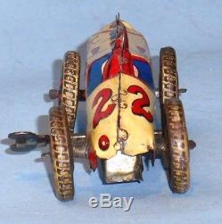 Tin wind-up open wheel vintage race car. 5 long, not rare. Near extinct