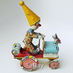 UNIQUE ART MFG JOJO THE DOG & ARTIE THE CLOWN TIN LITHO WithUP CIRCUS JUMPING CAR