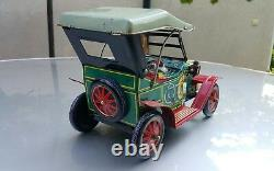 VNTG. RETRO CAR 1910 JALOPY MYSTERY ACTION TIN TOY BATTERY OPERATED 1960's JAPAN