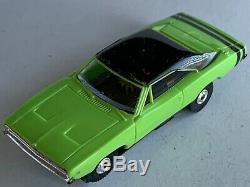 Vintage Aurora Thunderjet 500 1969 Dodge Charger HO Slot Car in LIME & Black