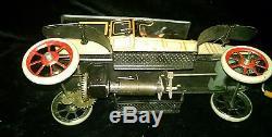 Vintage German Windup Tin Touring Car Toy with Latching Doors and Crank