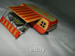 Vintage Japan tin toy trailer with car