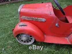 Vintage metal pedal car