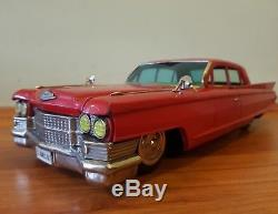 Vintage tin toy car. Bandai. Japan. Cadillac 17.5 inches. Friction. Works